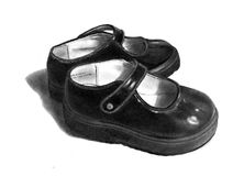 Pencil Drawing of Small Black Shoes. My freehand pencil drawing of a pair of small black girls' shoes Royalty Free Stock Photography