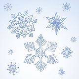 Pencil drawing snowflake sketch. Set of fun cute eve natal simple icy asterisk blue sky card template for wrapping nativity design. Freehand outline ink hand Stock Images