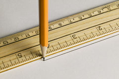 Pencil drawing a straight line with a ruler Stock Image