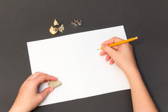 Pencil drawing on a white sheet. Man painting on a sheet of paper with a pencil Stock Photos