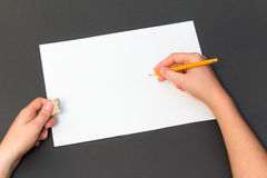 Pencil drawing on a white sheet. Man painting on a sheet of paper with a pencil Stock Images