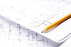 Pencil on drawings with drafts. Close-up with a pencil above drawings with sketches of projects royalty free stock photos