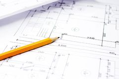 Pencil on drawings with drafts. Close-up with a pencil above drawings with sketches of projects stock photo