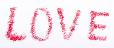Pencil drawn love word with red color Stock Images