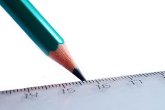 Pencil draws line on ruler. The pencil draws a line on the ruler royalty free stock image