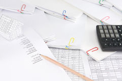 Pencil on earnings statement have blur house and paperwork Royalty Free Stock Photography