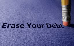 Erase Your Debt concept. Pencil with Erase Your Debt text on paper stock photography