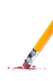 Pencil eraser. A pencil eraser removing a written mistake on a piece of paper Stock Image