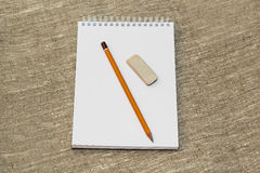 Pencil eraser and clean the notebook Royalty Free Stock Photos