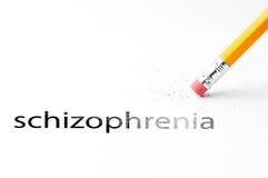Pencil with eraser. Closeup of pencil eraser and black schizophrenia text. Schizophrenia. Pencil with eraser Royalty Free Stock Images