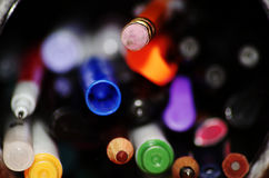 Pencil eraser in a container with many pencil crayons, pens and markers royalty free stock photo