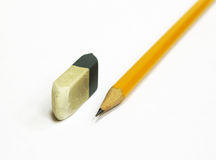 Pencil and eraser isolated. Isolated image of a pencil and hardly used eraser royalty free stock images