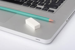Pencil and eraser on the laptop Royalty Free Stock Images