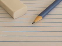 Pencil, eraser on lined paper. School supplies, ready to start writing a letter, a lesson, or an exercise, at the beginning of class Royalty Free Stock Images