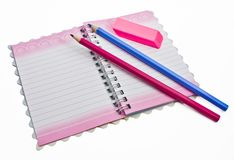 A pencil eraser, a notebook Stock Photo