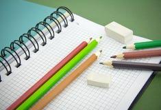 Pencil, eraser, notebook Stock Image
