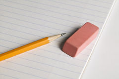 Pencil and eraser on a pad of paper Royalty Free Stock Photo