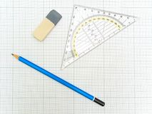Pencil and eraser at the plotting paper. Angle protractor, pencil and eraser at the plotting paper Stock Photo