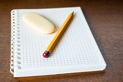 Pencil and eraser on the table Stock Photography