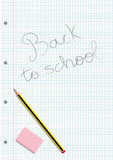 Pencil and eraser on a written notebook gridded sheet Stock Images