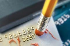 Erasing your debt. Pencil erasing credit card debt royalty free stock image