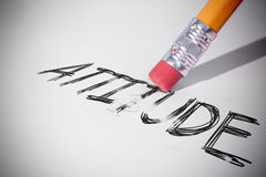 Pencil erasing the word Attitude. On paper royalty free stock photography