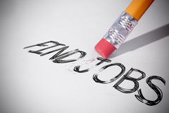 Pencil erasing the word Find jobs Royalty Free Stock Photos