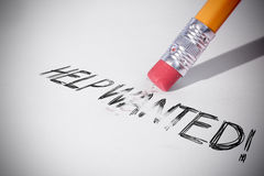 Pencil erasing the word Help wanted! Stock Photo