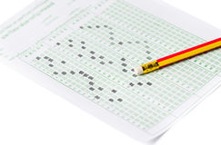 Pencil on examination test sheet. Isolated on white background Royalty Free Stock Photography