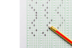 Pencil on examination test sheet isolated. On white with copy space Stock Photo