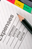 Pencil on expenses page Stock Images