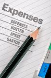 Pencil on expenses record Royalty Free Stock Image
