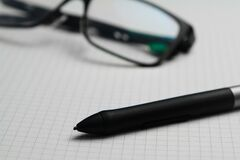 Pencil and eyeglasses on graph paper Royalty Free Stock Photo