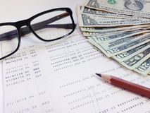 Pencil, eyeglasses, money and savings account passbook or financial statement on white background. Business, finance, savings, banking or  loan concept : Pencil Royalty Free Stock Images