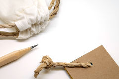 Pencil, fabric bag and  paper tag tones vintage. Craft set object, Pencil, fabric bag and  paper tag , Natural tones vintage Stock Photography