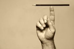 Pencil on a finger Royalty Free Stock Images