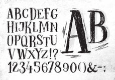 Pencil font black alphabet. Font pencil vintage hand drawn alphabet drawing in black color on dirty paper background Royalty Free Stock Photo