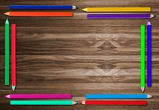 Pencil Frame  on old wooden background Stock Photo