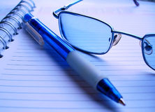 Pencil and glasses. Pencil nd glasses on the diary Stock Images