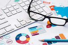 Free Pencil, Glasses And Keyboard On Graph Report Background Stock Photos - 74814583