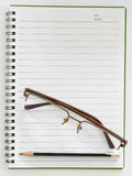 Pencil and glasses on paper note Stock Photo