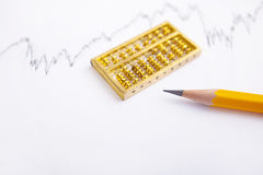 Pencil and gold abacus chart Stock Photos