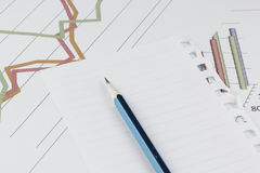 Pencil on graph background. Royalty Free Stock Photography