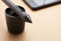 Pencil graphics for tablet and holder for it Stock Photography
