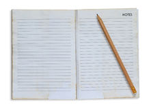 Pencil on grunge notebook Royalty Free Stock Photos
