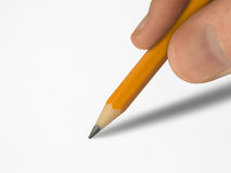 Pencil in hand. Clean paper, clipping path Royalty Free Stock Image