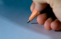 Pencil in hand Stock Photography