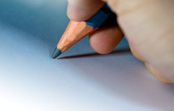 Pencil in hand close up Royalty Free Stock Image