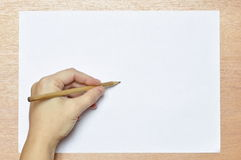 Pencil in hand. Royalty Free Stock Photos