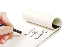 Pencil in hand writing. On the notebook Stock Images